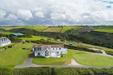 Silver Spray is surrounded by large lawned areas. The  countryside behind the house is as stunning as the seaviews