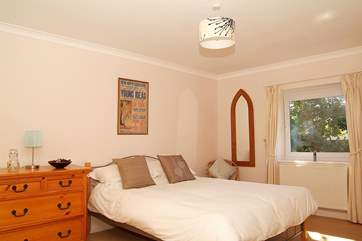 Spacious Bedroom 2 is furnished with a king-size bed.