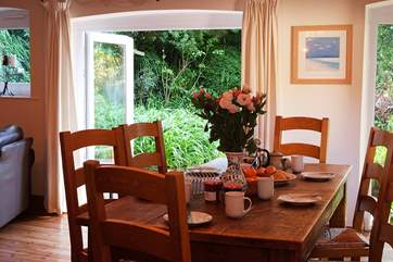 Breakfast is served with views over the garden.