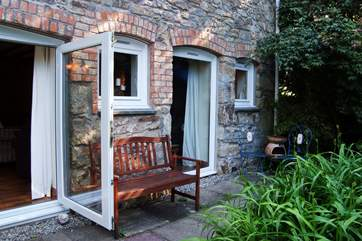 The front patio is a lovely place to sit at any time of day, fire up the chimenea if it gets a little chilly.