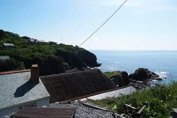 The garden is up behind the cottage (take care on the steep steps and the unfenced top terrace).