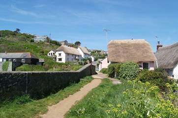 Looking back from The Todden, Kinsale is the second thatched cottage from the left.