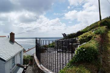 The railings to the rear of the cottage lead up to your private terrace.