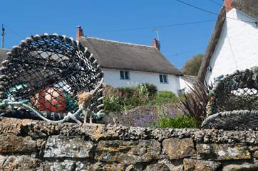 This lovely thatched cottage in the heart of this very pretty seaside village.