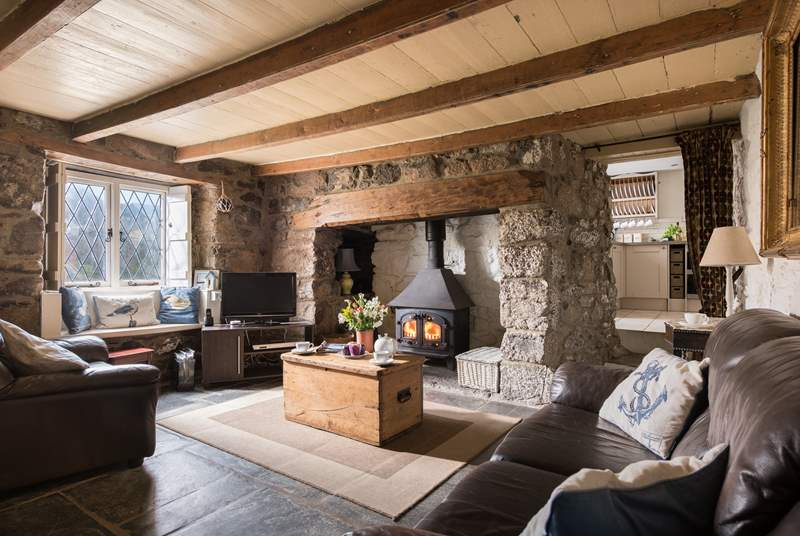 Room to relax with friends and family in this cosy cottage sitting-room.