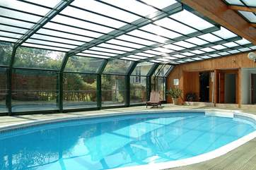 The pool house roof is sometimes opened when the weather is fine.