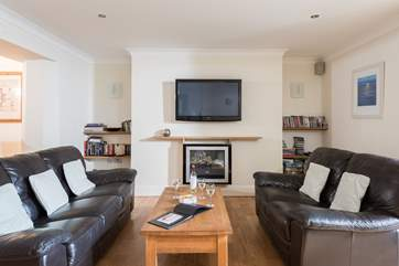 Comfortable sofas, a warming fire and a large TV to relax in front of with a good film.
