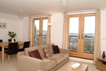 The open plan living-room is light and airy and has great views.