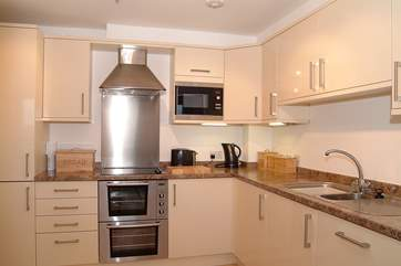 The kitchen is very well-equipped and has sea views too.
