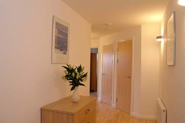 The spacious hallway leads to the bedrooms.