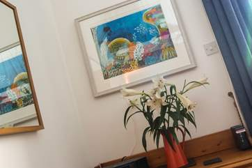 Colourful artwork throughout the apartment.