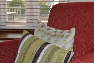 Bright cushions add colour.