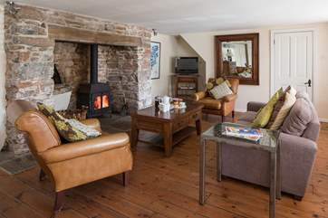 The wood burner makes this living room the perfect place to relax and unwind after a action packed day.