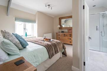 The master bedroom has a spacious en-suite shower-room.