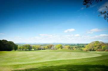 The golf course at Woodbury Park Country Cub - a stunning setting overlooking the Exe Valley with the hills of Dartmoor beyond.