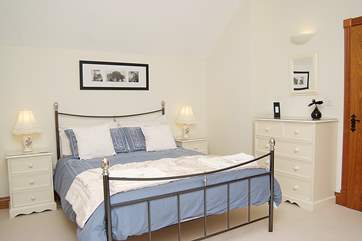 The exceptionally spacious master bedroom with king-sized bed.