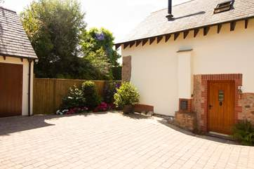 Another view of this beautifully maintained property and its spacious driveway.