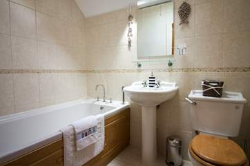 This is the family bathroom. With the downstairs shower room and the en-suite as well,  this is a very flexible property.