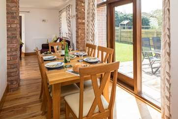 The dining area has French doors that open onto the patio and fully enclosed garden.