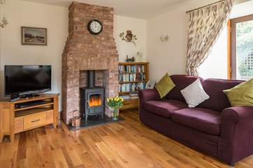 The dual-aspect sitting/dining-room has doors out to the garden and a wonderful wood-burner for cosy evenings in. There are two large sofas to snuggle up on.