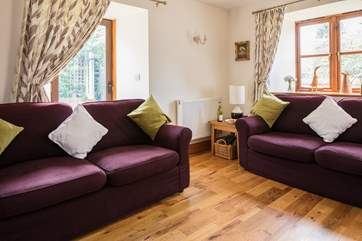 The sitting room has comfy sofas, ideal for relaxing after a day of exploring.