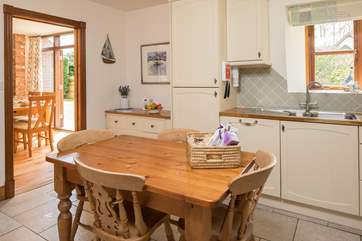 The delightful kitchen leads into the dining area.