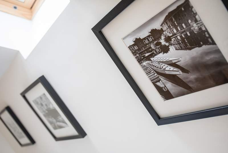 Lovely photos add to the homeliness of this cottage.