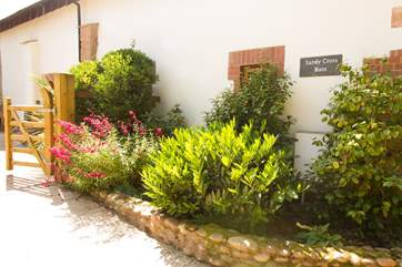 Pretty planting ensures that this property looks lovely whatever the time of year you stay.
