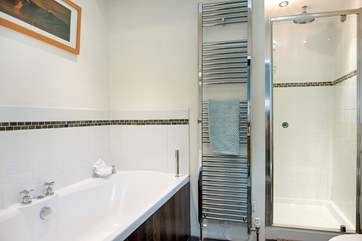Bedroom One's stylish en-suite bathroom which also has a separate shower