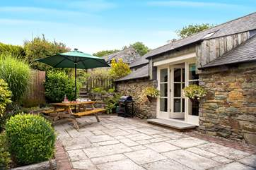At the rear of the cottage there is a sunny patio area and huge shared garden to play in- you won't want to leave