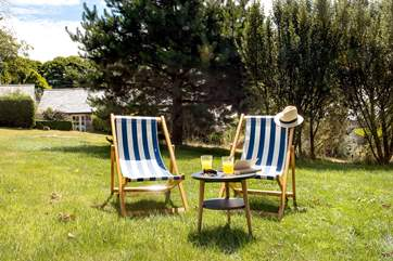 Enjoy the wonderful setting relaxing in the deck chairs