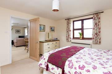 This bedroom is at one end of the cottage and the other bedroom is at the opposite end - so you will have plenty of privacy.