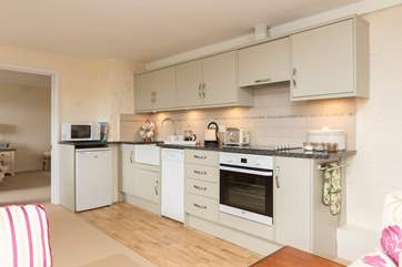 There is a contemporary kitchen which is very well-equipped.