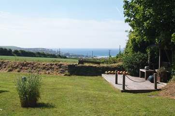 The deck area has superb views over fields to the sea beyond.