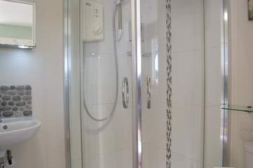 The shower-room has a quadrant shower cubicle and heated towel rail to warm the towels.
