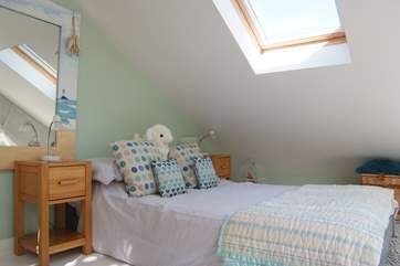 The cosy bedroom has sloping ceilings so mind your heads at the edges of the room!