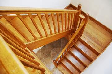 The solid oak staircase leading up to Bedroom 2 and the sitting-room.
