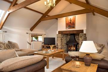 The very spacious sitting room is situated on the first floor and has a gorgeous woodburner making this an ideal retreat all year round
