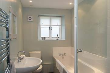 The well appointed bathroom also has a separate shower cubicle.