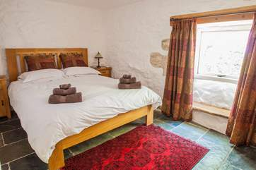 The lovely double bedroom has slate floors and a 5' double bed (Bedroom 1).