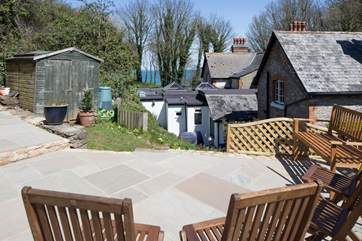 There is a raised patio at the top of the garden with views of the sea.