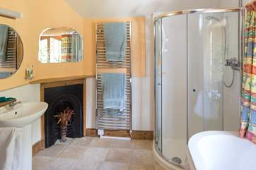 There is a separate shower in the family bathroom.