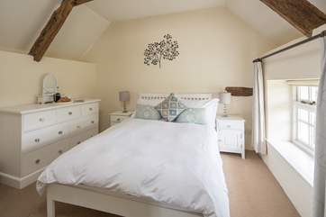 This is the main bedroom (Bedroom 1) with gentle colours and a really comfy bed.