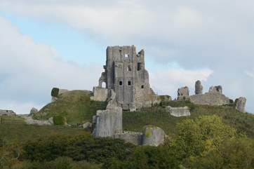 The National Trust's Corfe castle looks out over the pretty village of Corfe, summer concerts and performances are held in the gardens.