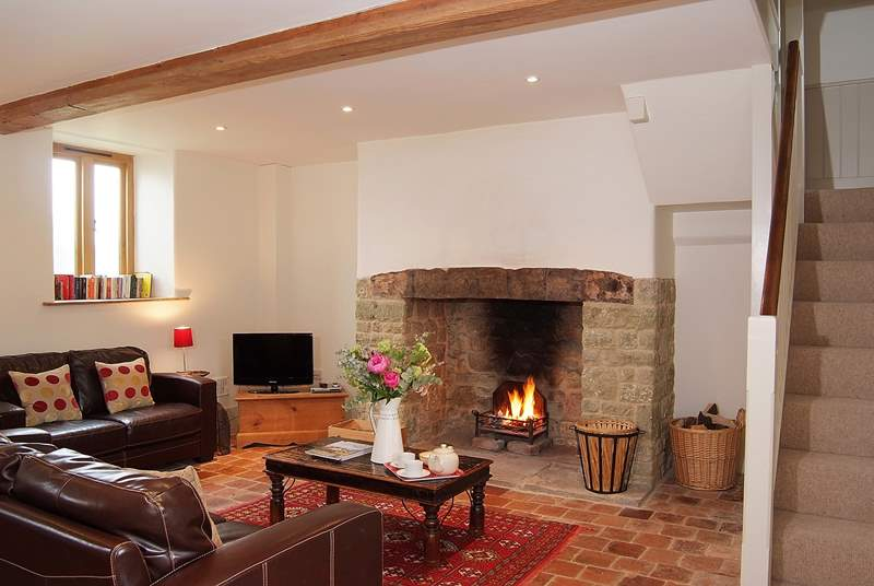 The open fire adds even more character to this lovely barn conversion. (Please note, the owners will be replacing the sofas for the 2019 season)