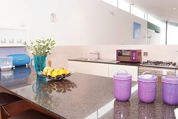 The sleek kitchen is extremely well-equipped.