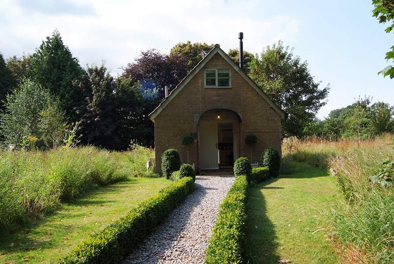 This is the view of The Pump House as you pull up into the dedicated parking-area. It is in its own private wildlife meadow with an additional garden to enjoy too.