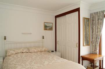 The master bedroom has a double bed (Bedroom 1).