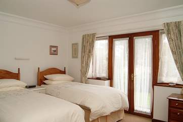 The second bedroom has 'zip and link' beds, shown here as 3' twin beds  and also available as a 6' double bed (Bedroom 2).