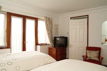 The second bedroom has an en suite shower room.